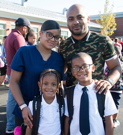 09/03/19 Wesley Bunnell | StaffrrEdgailyn Perez, back L, and husband Jeremy Sykes pose for photos with children Riley Sykes, bottom L, and Caiden Sykes on their first day back at Smalley School.