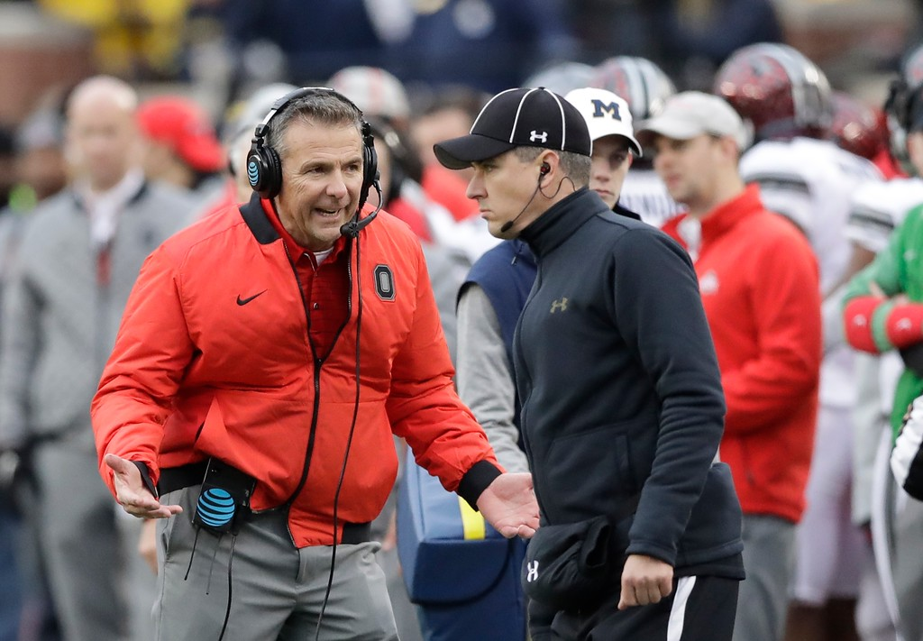 . Ohio State head coach Urban Meyer reacts after a call during the second half of an NCAA college football game against Michigan, Saturday, Nov. 25, 2017, in Ann Arbor, Mich. (AP Photo/Carlos Osorio)