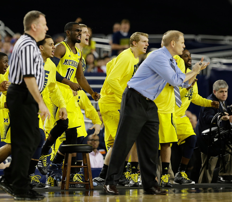 . The Michigan bench reacts during the second half of a regional semifinal game against Kansas in the NCAA college basketball tournament, Friday, March 29, 2013, in Arlington, Texas. (AP Photo/Tony Gutierrez)