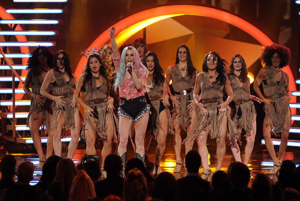 . Singer Ke$ha (C) performs onstage during the 2013 American Music Awards at Nokia Theatre L.A. Live on November 24, 2013 in Los Angeles, California.  (Photo by Kevin Winter/Getty Images)