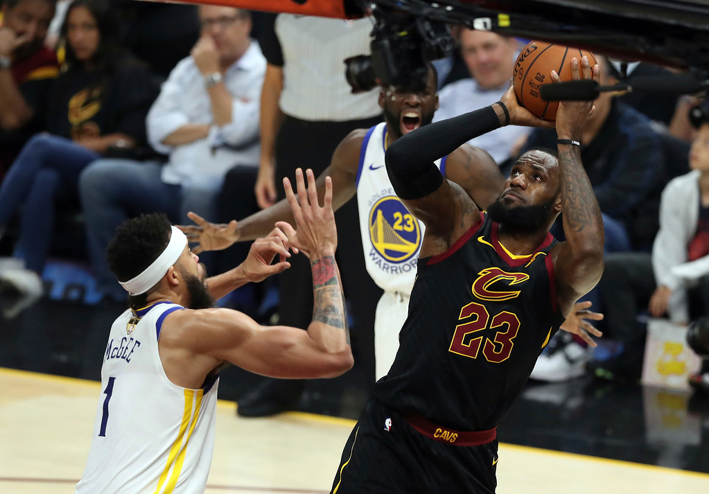 . Cleveland Cavaliers\' LeBron James shoots over Golden State Warriors\' JaVale McGee during the first half of Game 4 of basketball\'s NBA Finals, Friday, June 8, 2018, in Cleveland. (AP Photo/Carlos Osorio)