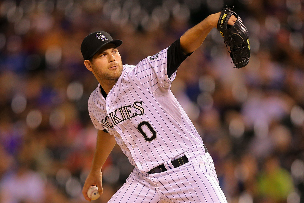 . Relief pitcher Adam Ottavino #0 of the Colorado Rockies delivers to home plate during the ninth inning against the Pittsburgh Pirates at Coors Field on July 25, 2014 in Denver, Colorado. The Rockies defeated the Pirates 8-1. (Photo by Justin Edmonds/Getty Images)