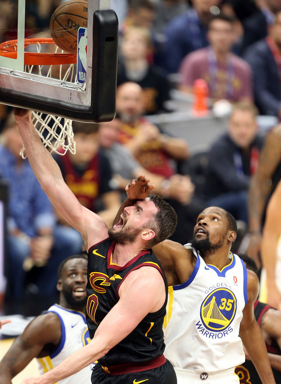 . Cleveland Cavaliers center Kevin Love gets a hand to the face from Golden State Warriors forward Kevin Durant during the first half of Game 3 of basketball\'s NBA Finals on Wednesday, June 6, 2018, in Cleveland. (Joshua Gunter/Cleveland.com via AP)