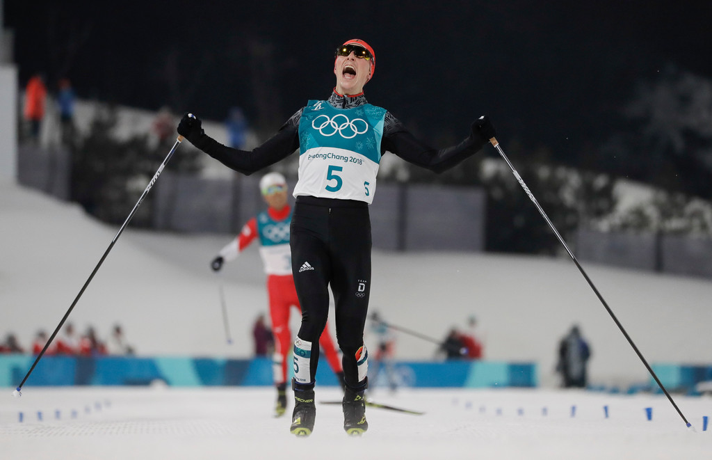 . Eric Frenzel, of Germany, celebrates after winning the the gold medal after the 10km cross-country skiing portion of the nordic combined event at the 2018 Winter Olympics in Pyeongchang, South Korea, Wednesday, Feb. 14, 2018. (AP Photo/Kirsty Wigglesworth)
