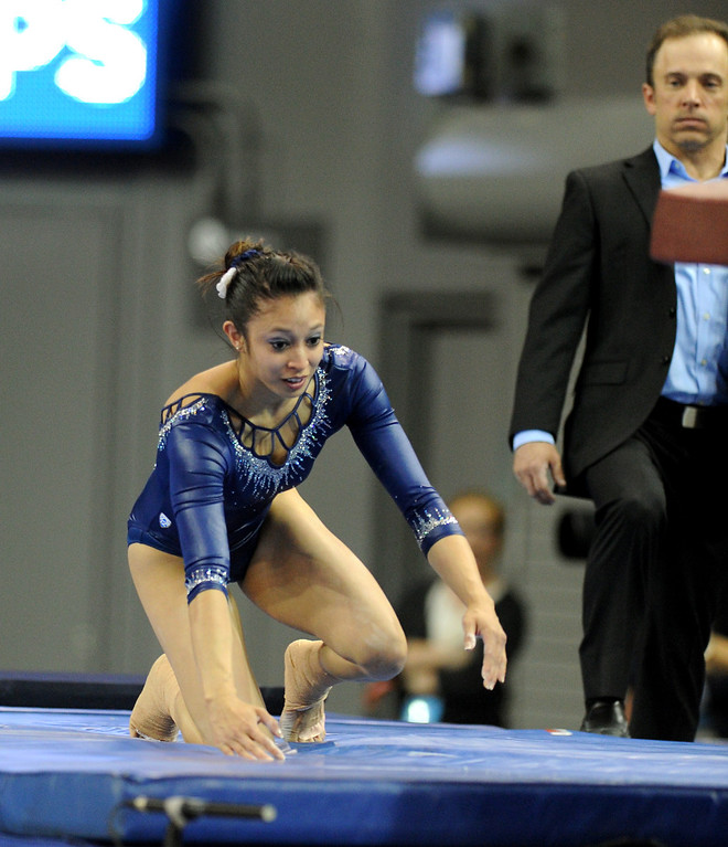 . UCLA\'s Vanessa Zamarripa gets up after landing on her knees while competing in the vault at the NCAA Women\'s Gymnastics Championship Team Finals at Pauley Pavilion, Saturday, April 20, 2013. (Michael Owen Baker/Staff Photographer)