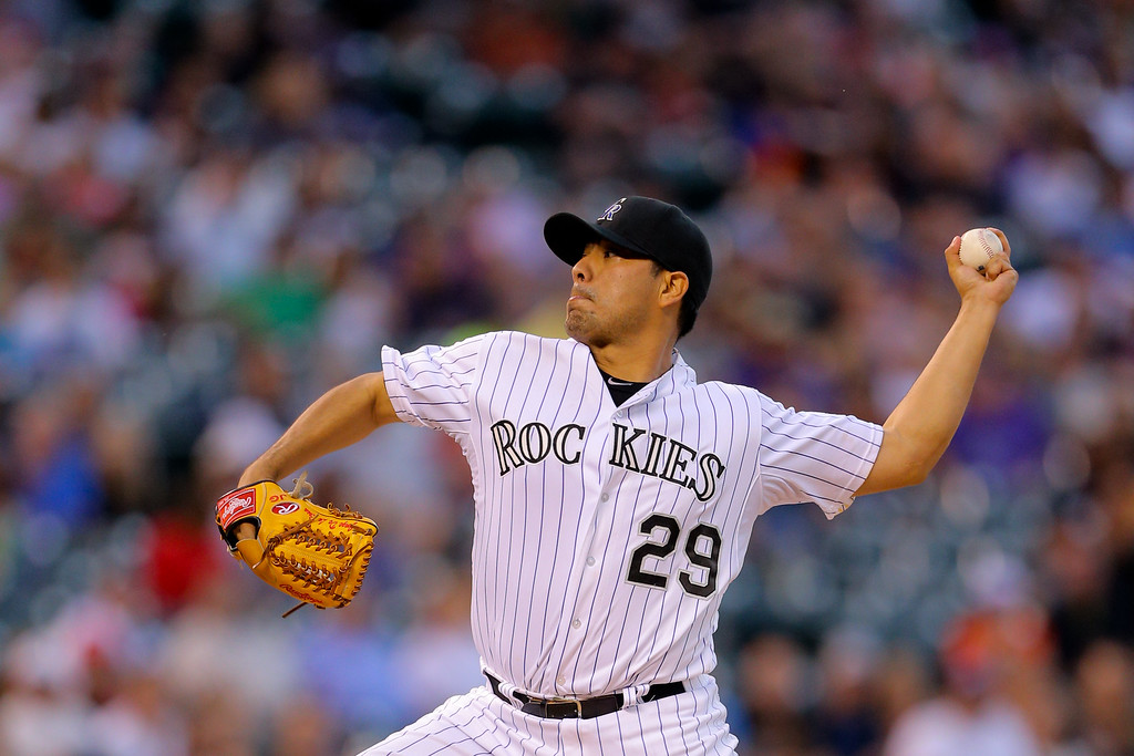 . DENVER, CO - SEPTEMBER 6:  Starting pitcher Jorge De La Rosa #29 of the Colorado Rockies delivers to home plate during the third inning against the San Diego Padres at Coors Field on September 6, 2014 in Denver, Colorado. (Photo by Justin Edmonds/Getty Images)