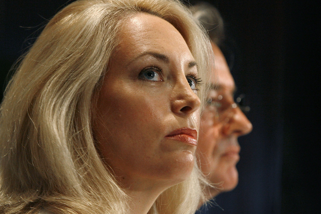 """. WASHINGTON - JULY 14:  Retired CIA employee Valerie Plame Wilson (L) and her husband, former diplomat Joe Wilson, hold a press conference where they announced a lawsuit against senior members of the Bush Administration at the National Press Club July 14, 2006 in Washington, DC. Plame filed suit in U.S. District Court July 13, 2006, charging that Vice President Dick Cheney, his aide, I Lewis \""""Scooter\"""" Libby, and presidential advisor Karl Rove destroyed her career when they leaked her identity to the press.   (Photo by Chip Somodevilla/Getty Images)"""