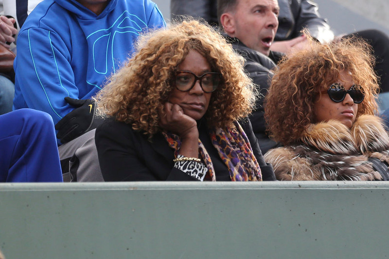 . Oracene Price, mother of Venus Williams of the U.S., center, watches her daughter\'s first round match against Poland Urszula Radwanska at the French Open tennis tournament in Roland Garros stadium in Paris, Sunday, May 26, 2013. (AP Photo/Michel Euler)