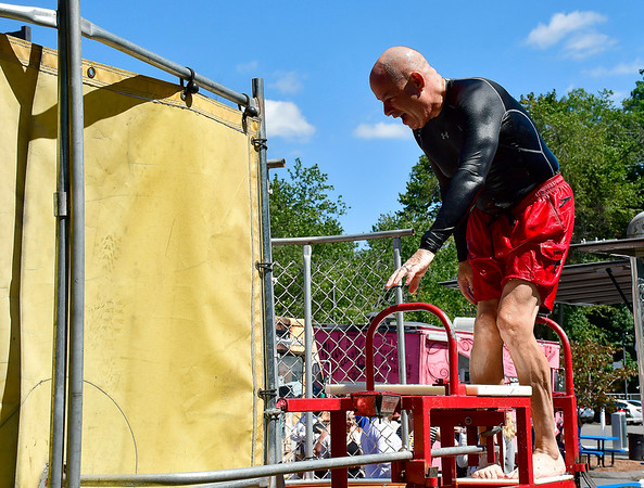 8/29/2019 Mike Orazzi | Staff Kurt A. Barwis, FACHE, President and CEO, of the Bristol Hospital & Health Care Group throws in the dunk tank during the Bristol Hospital Foundation's Food Truck Festival to raise funds for the emergency center renovation and expansion project on Thursday.