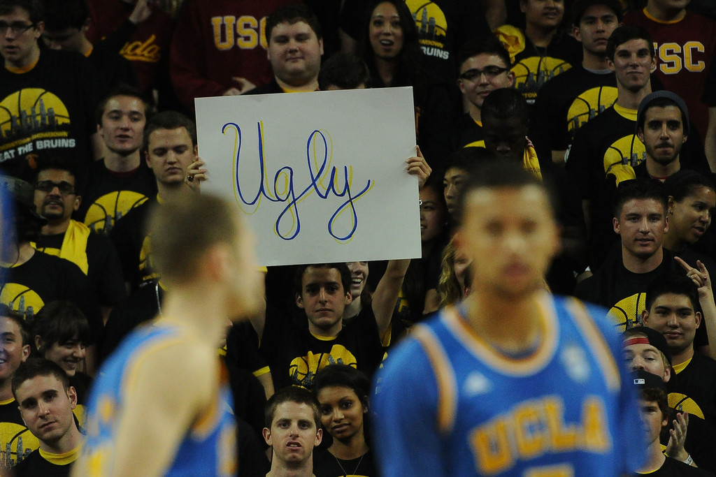 ". A Southern California fan holds up a ""Ugly\"" sign after taking the lead over UCLA in the first half of a PAC-12 NCAA basketball game at Galen Center in Los Angeles, Calif., on Saturday, Feb. 8, 2014. (Keith Birmingham Pasadena Star-News)"