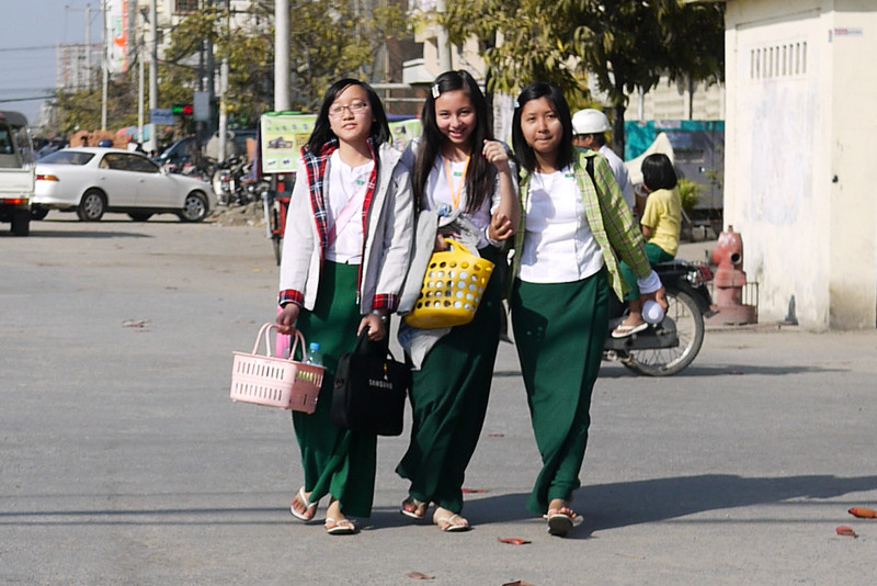 Shy smiles from some school girls making their way home on the streets of Mandalay