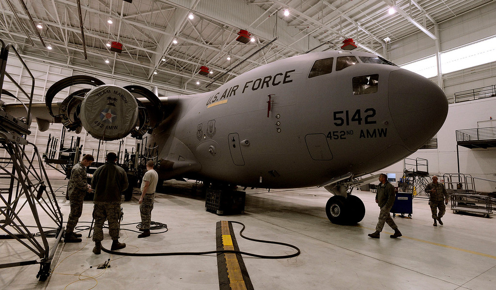. Air Reserve Technicians perform maintenance on the C-17A Globemaster at March Air Reserve Base in Riverside March 6, 2013.  The base is one of many bases that will be affected by the Federal sequestration.  GABRIEL LUIS ACOSTA/STAFF PHOTOGRAPHER.