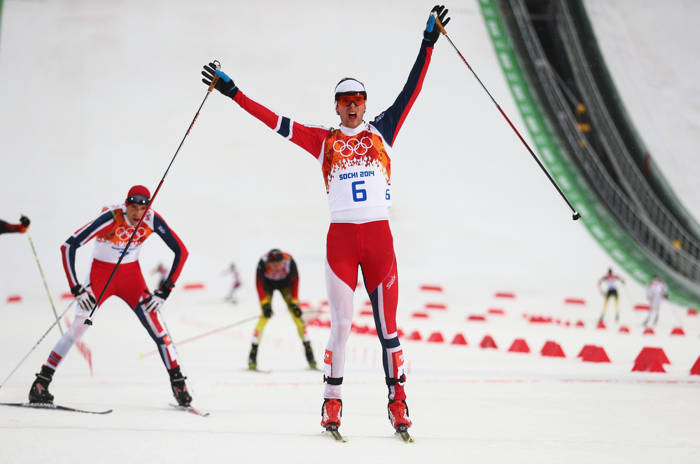 . Joergen Graabak of Norway celebrates as he crosses the line to win the gold medal ahead of Magnus Hovdal Moan of Norway in the Nordic Combined Men\'s 10km Cross Country during day 11 of the Sochi 2014 Winter Olympics at RusSki Gorki Nordic Combined Skiing Stadium on February 18, 2014 in Sochi, Russia.  (Photo by Clive Mason/Getty Images)