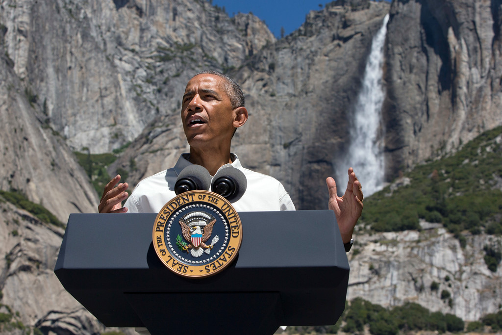 . President Barack Obama speaks by the Sentinel Bridge in the Yosemite Valley, in front of Yosemite Falls which is the highest waterfall in the park at Yosemite National Park, Calif., on Saturday, June 18, 2016. The Obama family traveled to Yosemite to celebrate the 100th anniversary of the creation of America\'s national park system. (AP Photo/Jacquelyn Martin)