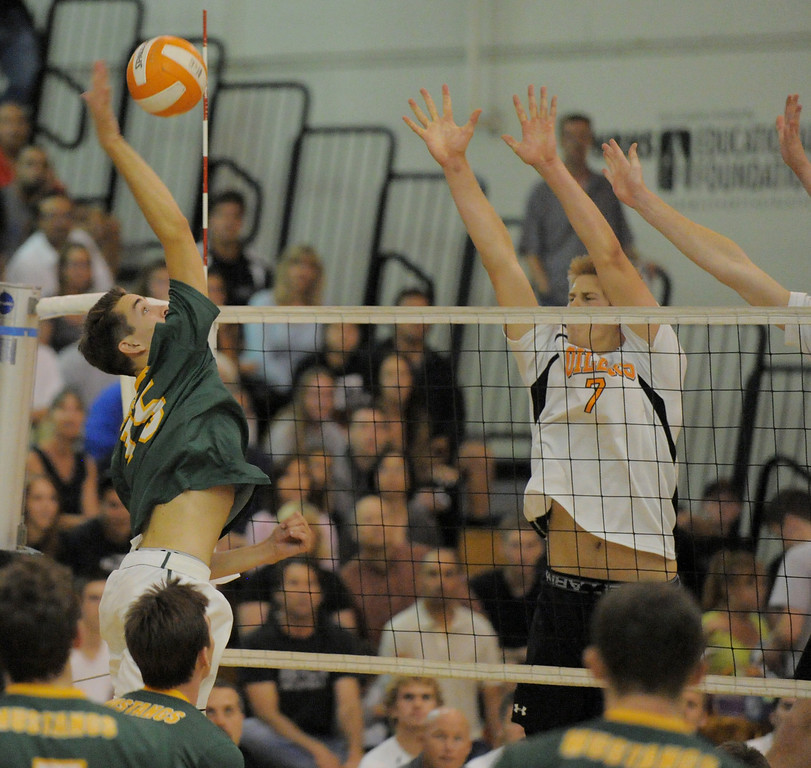 . 05-15-2013-( Daily Breeze Staff Photo by Sean Hiller) Huntington Beach swept Mira Costa in Wednesday\'s  boys volleyball CIF Southern Section Division I semifinal at Huntington Beach High School. Riley Mallon goes to the net for Costa.