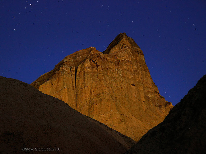 Manly Beacon under a star filled night sky in Golden Canyon, Death Valley, California.