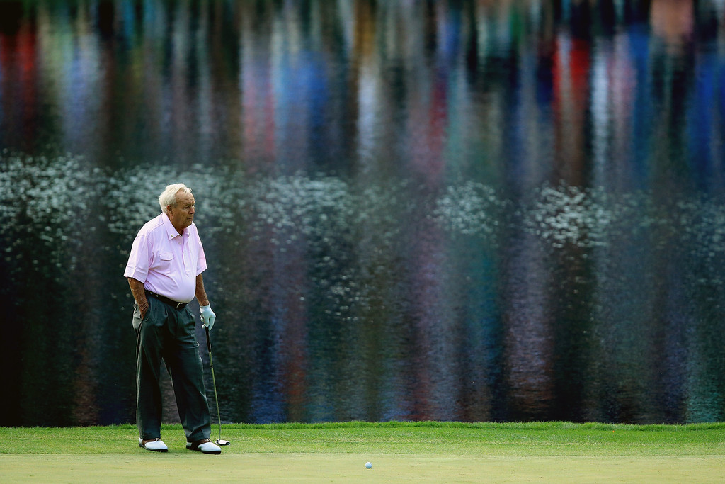 . Arnold Palmer waits on a green during the 2014 Par 3 Contest prior to the start of the 2014 Masters Tournament at Augusta National Golf Club on April 9, 2014 in Augusta, Georgia.  (Photo by David Cannon/Getty Images)