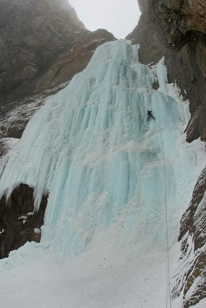 An ice climber climbing Polar Circus WI5, Banff National Park, Alberta, Canada.