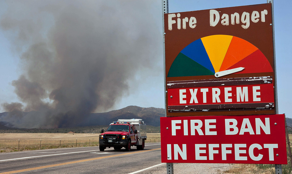. A fire engine moves along Hays Ranch Road as the Yarnell Hill Fire advances on Peeples Valley, Ariz. on Sunday, June 30, 2013. The fire started Friday and picked up momentum as the area experienced high temperatures, low humidity and windy conditions. It has forced the evacuation of residents in the Peeples Valley area and in the town of Yarnell. (AP Photo/The Arizona Republic, Tom Story)