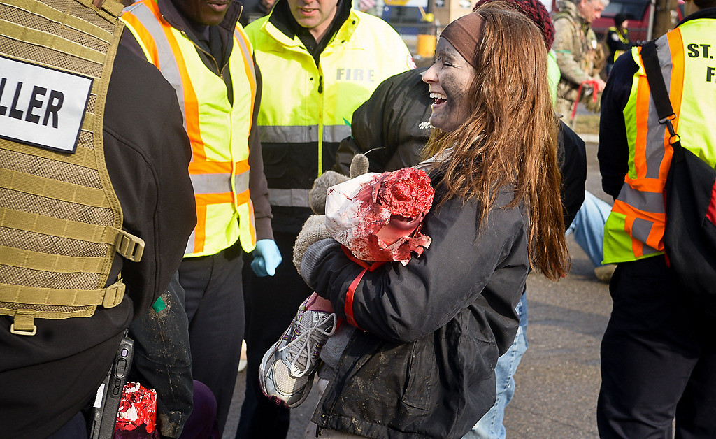 . Tensions were low as Becki Maki laughs while holding her fake stump while chatting with law enforcement officers towards the end of the full-scale emergency preparedness exercise near TFC Bank Stadium in Minneapolis. (Pioneer Press: Ben Garvin)