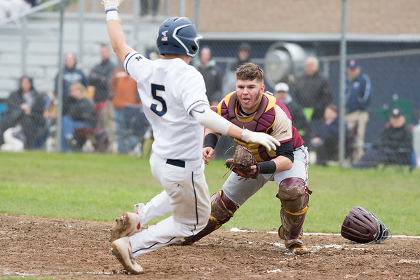 05/14/19 Wesley Bunnell | Staff Newington baseball defeated New Britain 4-3 in a walk off on Tuesday afternoon at Newington High School. Michael Gajda (15) tags out the Newington runner Gunnar Johnson (5).