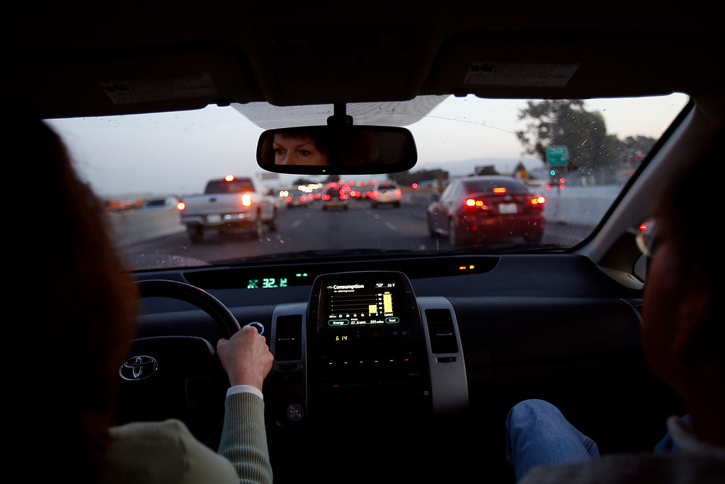 . Jan Richards, left, drives south on I-880 with her husband Gary, also known as Mr. Roadshow, as they drive home in their Toyota Prius from the San Jose Mercury News office in San Jose, Calif., on March 4, 2013.  Richards is writing a column about how he cannot drive for six to eight months while his right foot heals. The theme is how this affects the Merc\'s Mr. Roadshow columnist and now is an issue that many older motorists will be facing as our population ages and driving skills diminish.  His wife Jan must now drive him everywhere he needs to go, including to and from work until his foot heals.  (Nhat V. Meyer/Staff)