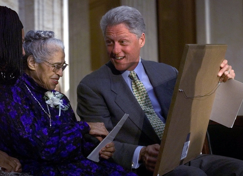. Rosa Parks, left, talks with President Clinton during a Capitol Hill ceremony where Mrs. Parks was honored with the Congressional Gold Medal Tuesday, June 15, 1999, in Washington. Clinton signed a bill last month bestowing Congress\' highest recognition on the 86-year-old Mrs. Parks. (AP Photo/Khue Bui)