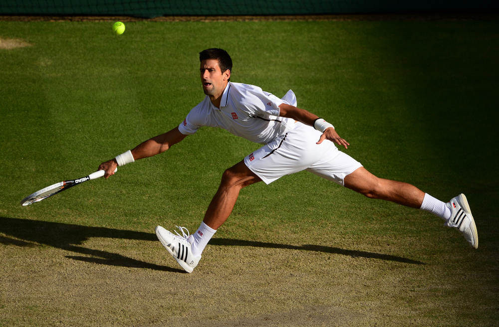 . Novak Djokovic of Serbia plays a forehand during the Gentlemen\'s Singles fourth round match against Tommy Haas of Germany on day seven of the Wimbledon Lawn Tennis Championships at the All England Lawn Tennis and Croquet Club on July 1, 2013 in London, England.  (Photo by Mike Hewitt/Getty Images)