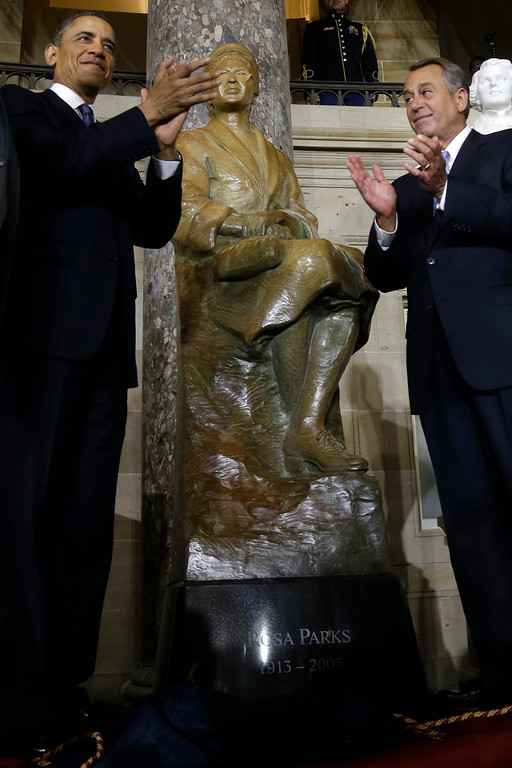 . President Barack Obama and House Speaker John Boehner of Ohio applaud at the unveiling of a statue of Rosa Parks, Wednesday, Feb. 27, 2013, on Capitol Hill in Washington.  (AP Photo/Charles Dharapak)