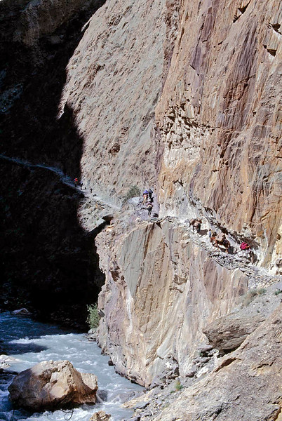 The verticle cliff wall to the frozen river where a misstep means certain death. Zanskar, India