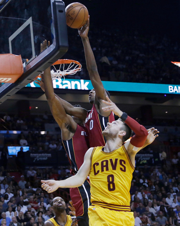 . Miami Heat guard Josh Richardson (0) blocks a shot by Cleveland Cavaliers guard Matthew Dellavedova (8) during the first half of an NBA basketball game, Saturday, March 19, 2016, in Miami. (AP Photo/Lynne Sladky)