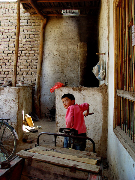 Child in courtyard of village home near Kashgar DSC01995.jpg