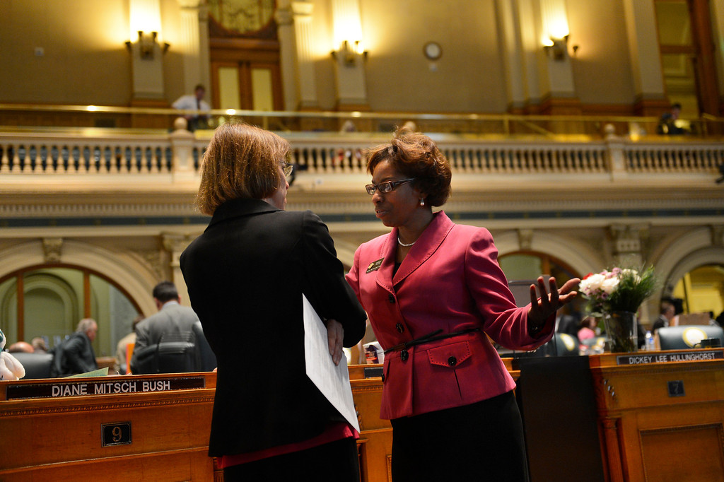 . DENVER, CO. - FEBRUARY 15: Representative Rhonda Fields and Representative Claire Levy talk after the break for lunch as the House debates HB 1224 prohibiting large capacity ammunition magazines at the Denver State Capitol February 15, 2013. Denver, Colorado. (Photo By Joe Amon/The Denver Post)