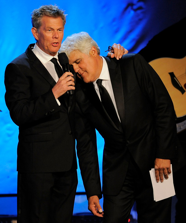 . Music director David Foster, left, and host Jay Leno share the stage during The 26th Carousel of Hope Gala at The Beverly Hilton Hotel on Saturday, Oct. 20, 2012, in Beverly Hills, Calif. (Photo by Chris Pizzello/Invision/AP)
