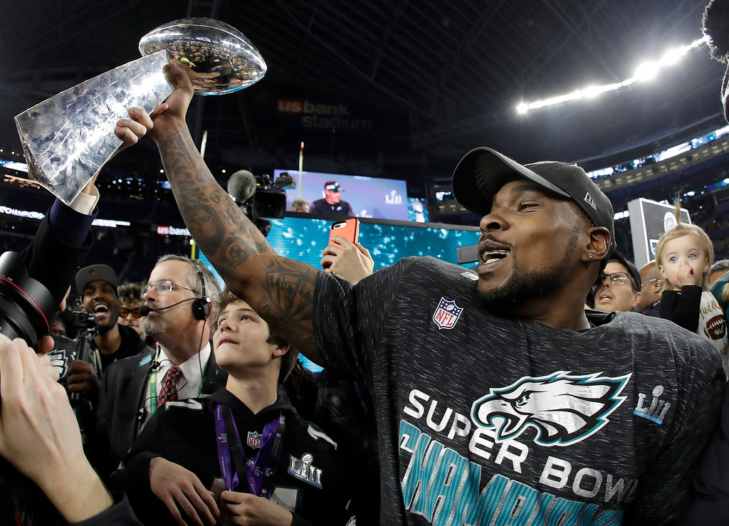 . Philadelphia Eagles\' Nigel Bradham holds up the Vince Lombardi Trophy after the NFL Super Bowl 52 football game against the New England Patriots, Sunday, Feb. 4, 2018, in Minneapolis. The Eagles won 41-33. (AP Photo/Matt Slocum)