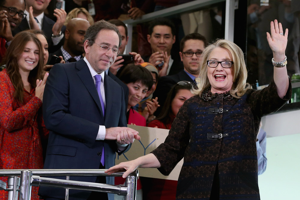 """. U.S. Secretary of State Hillary Clinton (R) waves goodbye after delivering her farewell address to the staff with Deputy Secretary of State for Management and Resources Tomas Nides (L) in the C Street lobby of the State Department on February 1, 2013 in Washington, DC. With a strong record in exerting what she called \""""soft power,\"""" Clinton is leaving the State Department and the Obama Administration after traveling 956,733 miles and visiting some 112 countries.  (Photo by Chip Somodevilla/Getty Images)"""