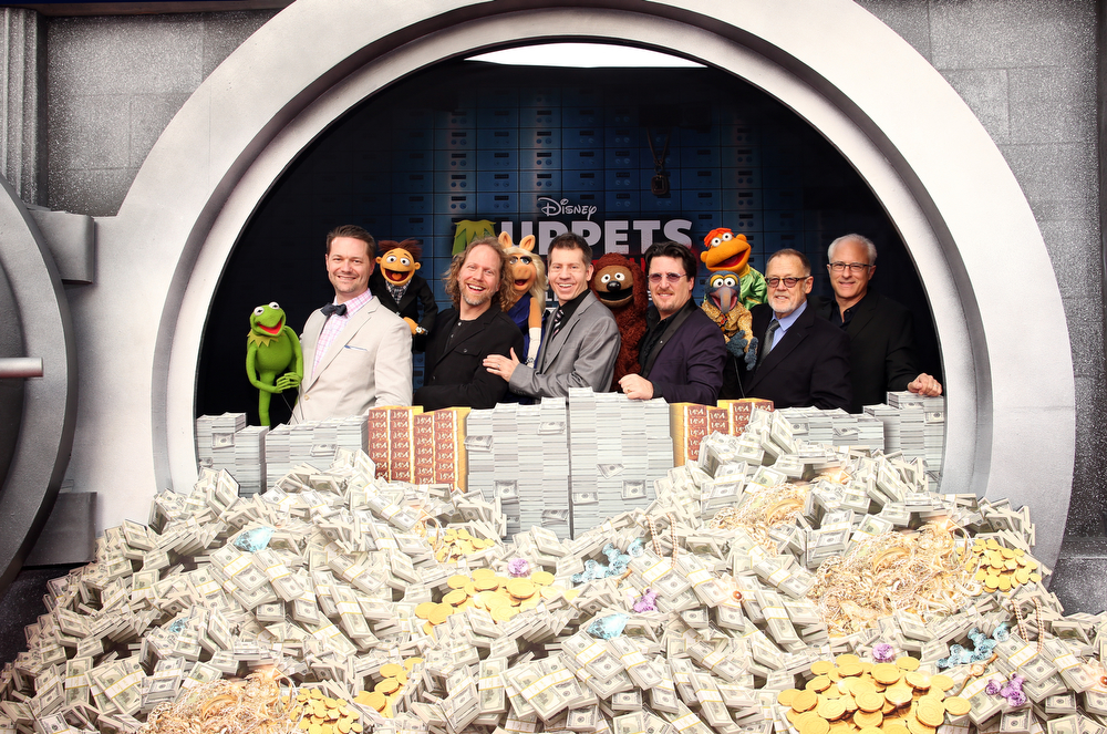 """. (L-R) Constantine, puppeteer Matt Vogel, Walter, puppeteer Peter Linz, Miss Piggy, puppeteer Eric Jacobson, Rowlf, puppeteer Bill Barretta, Gonzo, Scooter and puppeteers Dave Goelz and David Rudman arrive at the world premiere of Disney\'s \""""Muppets Most Wanted\"""" at the El Capitan Theatre on March 11, 2014 in Hollywood, California.  (Photo by Christopher Polk/Getty Images for Disney)"""