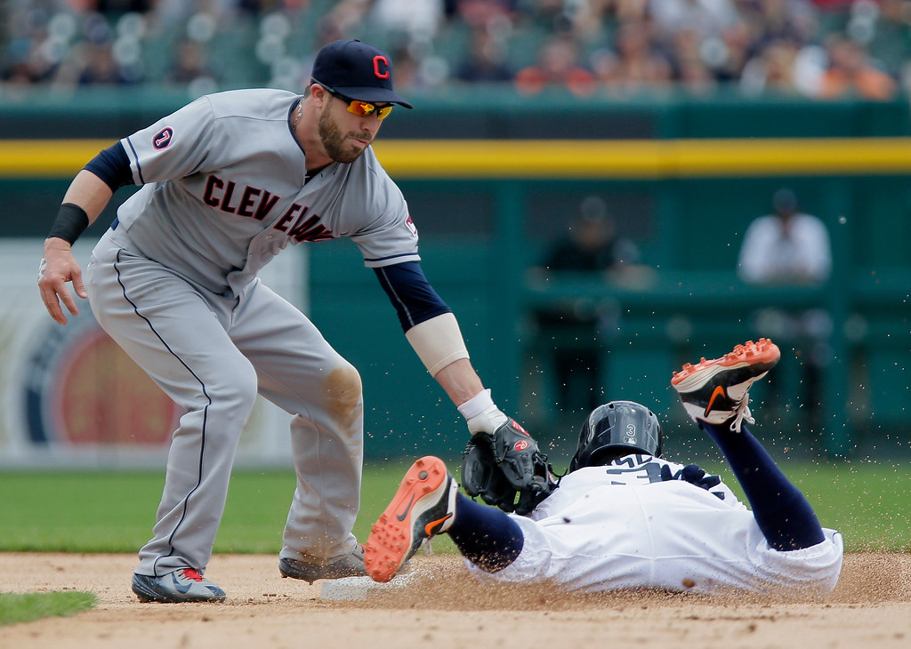 . Detroit Tigers\' Ian Kinsler, right, is tagged out by Cleveland Indians second baseman Jason Kipnis while  trying to steal second base during the first inning of a baseball game Sunday, June 14, 2015, in Detroit. (AP Photo/Duane Burleson)