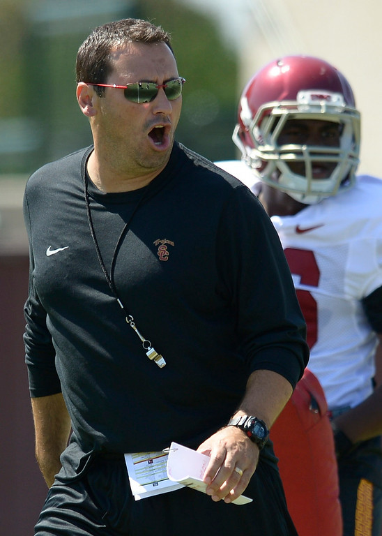 . Steve Sarkisian shouts out orders. Football practice is in full swing on the Howard Jones Field at USC. Los Angeles, CA. 8/6/2014(Photo by John McCoy Daily News)