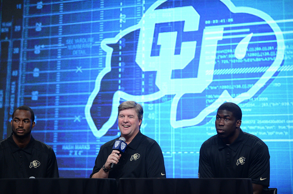 . Colorado Coach Mike Macintyre with players Paul Richardson and Chidera Uzo-Diribe. Pac12 media Day at Sony Studios.  Photo by Brad Graverson 7-26-13