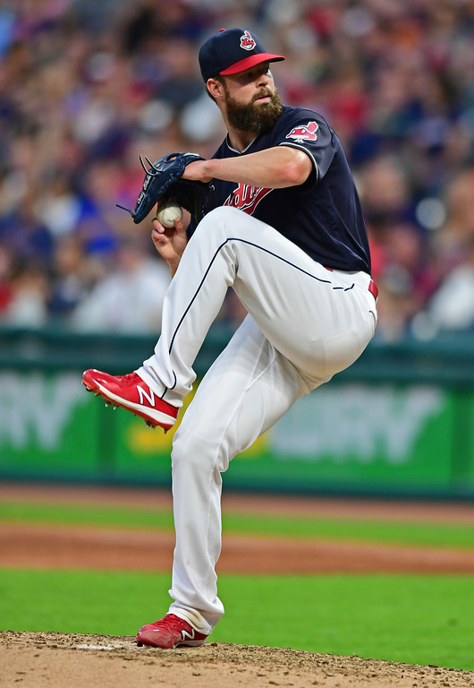 . Cleveland Indians starting pitcher Corey Kluber winds up during the sixth inning of the team\'s baseball game against the Houston Astros, Friday, May 25, 2018, in Cleveland. (AP Photo/David Dermer)