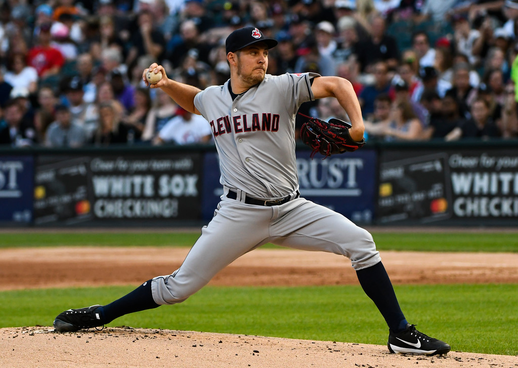 . Cleveland Indians starting pitcher Trevor Bauer delivers against the Chicago White Sox during the first inning of a baseball game Saturday, Aug. 11, 2018, in Chicago. (AP Photo/Matt Marton)