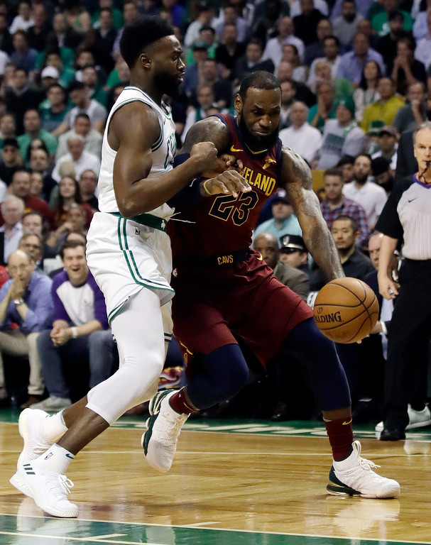 . Cleveland Cavaliers forward LeBron James, right, drives against Boston Celtics guard Jaylen Brown during the first half in Game 2 of the NBA basketball Eastern Conference finals, Tuesday, May 15, 2018, in Boston. (AP Photo/Charles Krupa)