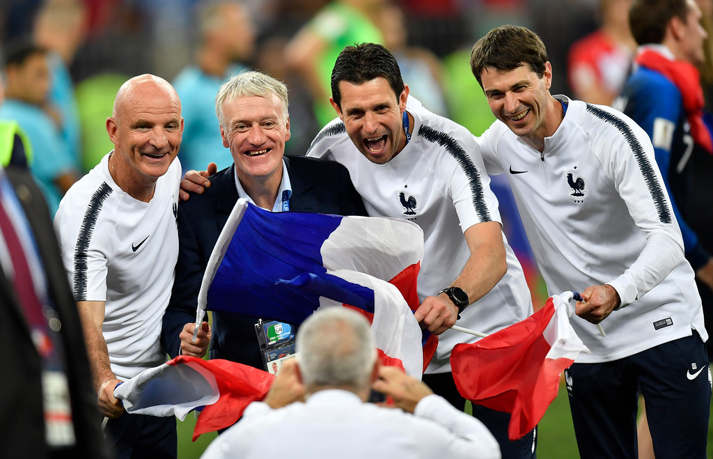 . France head coach Didier Deschamps, second from left, and his team pose for a photo after their team won 4-2 during the final match between France and Croatia at the 2018 soccer World Cup in the Luzhniki Stadium in Moscow, Russia, Sunday, July 15, 2018. (AP Photo/Martin Meissner)