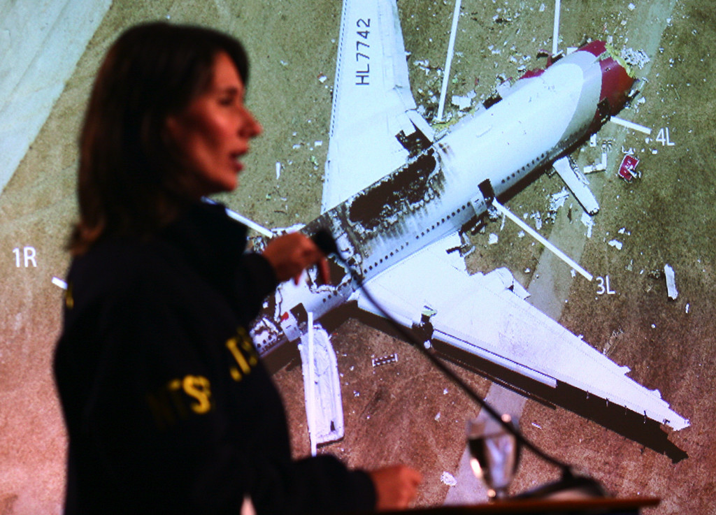 . National Transportation Safety Board Chairwoman Deborah Hersman conducts a briefing on the Asiana Airlines Flight 214 crash investigation as a photo of the plane is projected onto a screen, from a hotel near the San Francisco International Airport, in South San Francisco, Calif., on Wednesday, July 10, 2013. The Boeing 777 plane operated by a Korean airline crashed as it was landing at SFO on Saturday, July 6 killing two and injuring close to 200 passengers. (Anda Chu/Bay Area News Group)
