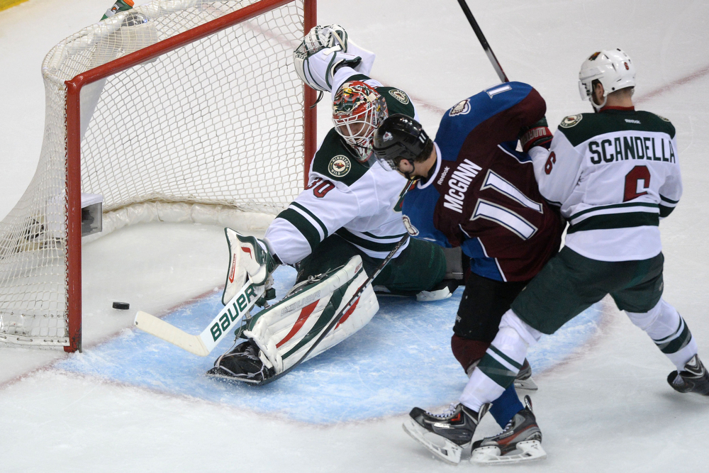 . Jamie McGinn (11) of the Colorado Avalanche scores a 4-3 goal to bring the Avs within one as Ilya Bryzgalov (30) of the Minnesota Wild tends the net during the third period of action. The Colorado Avalanche hosted the Minnesota Wild during the first round of the NHL Stanley Cup Playoffs at the Pepsi Center on Thursday, April 17, 2014. (Photo by Karl Gehring/The Denver Post)