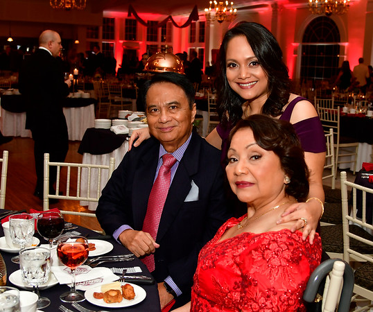 11/17/2018 Mike Orazzi | Staff Dr. Margarita Reyes and her parents Romeo and Lucita during Bristol Hospitals Annual Ball held at the Aqua Turf Club in Southington. All proceeds will benefit the Emergency Center expansion and renovation project.
