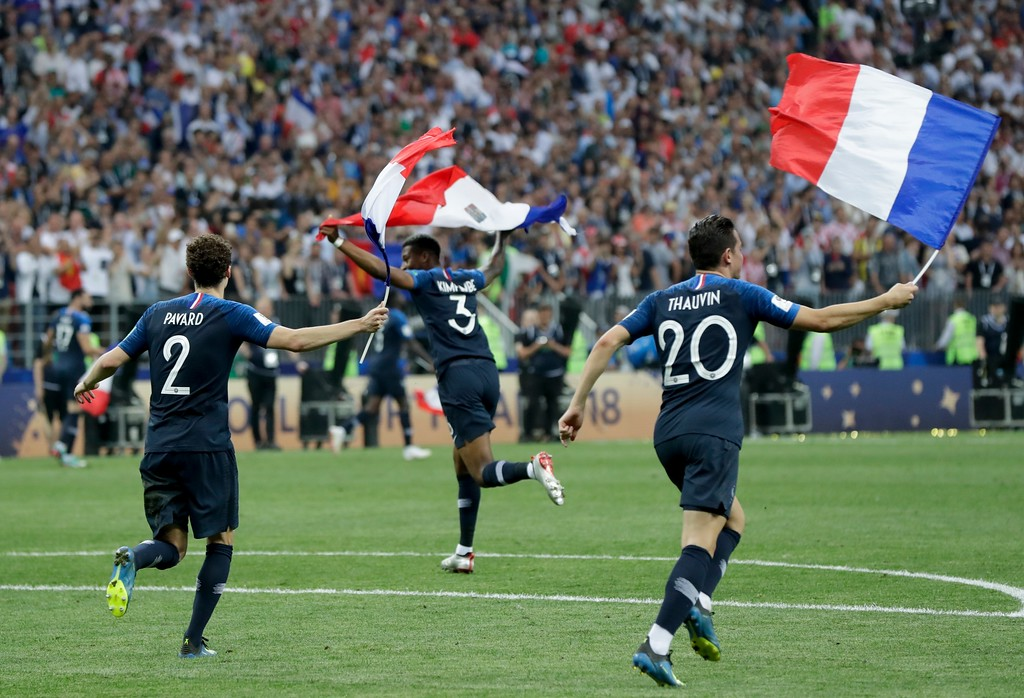 . From left, France\'s Benjamin Pavard, Presnel Kimpembe and Florian Thauvin celebrate at the end of the final match between France and Croatia at the 2018 soccer World Cup in the Luzhniki Stadium in Moscow, Russia, Sunday, July 15, 2018. France won 4-2. (AP Photo/Petr David Josek)