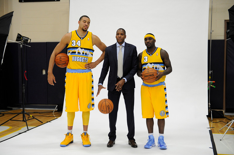 . Denver Nuggets JaVale McGee (34) looks down at Masai Ujiri, Denver Nuggets General Manager and Ty Lawson as they pose for portraits  during Media Day at Pepsi Monday, October 1, 2012 at Pepsi Center. The team also unveiled their new alternate uniform. John Leyba, The Denver Post