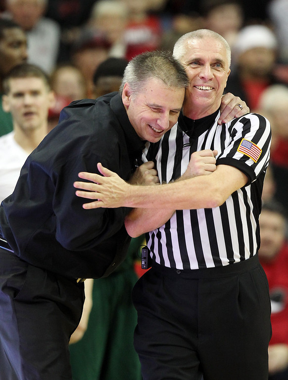 . Colorado State head coach Larry Eustachy, left, embraces official Shawn Lehigh during the second half of an NCAA college basketball game against UNLV on Wednesday, Feb. 20, 2013, in Las Vegas. UNLV defeated Colorado State 61-59. (AP Photo/Isaac Brekken)